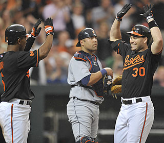 While the crowd came for Matt Wieters, they stay for Luke Scott (right) and his homer show. (AP)