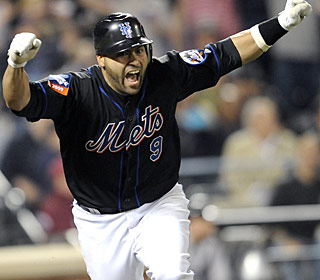 Omir Santos makes it happen for the Mets first with a homer, then with a game-ending RBI single. (AP)