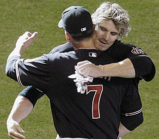 D-Backs manager A.J. Hinch hugs Eric Byrnes after his walk-off single in the 11th.  (AP)