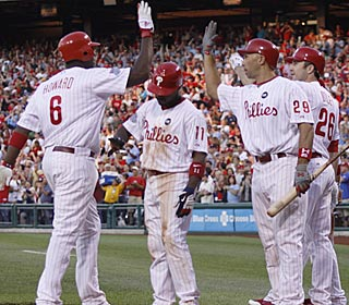 Ryan Howard greets his teammates after hitting his club-record eighth grand slam.  (AP)