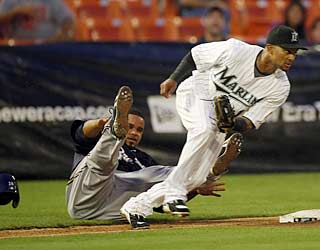 Emilio Bonifacio makes Prince Fielder pay for trying to steal third during the third inning.  (AP)
