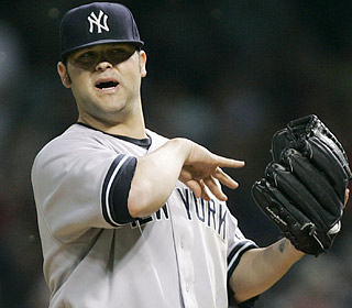Joba Chamberlain has no problem counting on the Yanks defense during a career-high eight innings.  (AP)