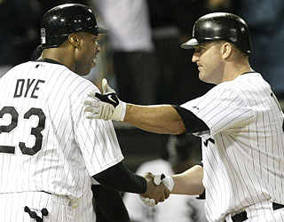 Jermaine Dye congratulates Jim Thome on home run No. 550, which breaks a 2-2 tie in the eighth.  (AP)