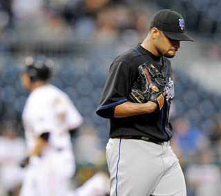 Pirates catcher Jason Jaramillo hits his first major league home run at Johan Santana's expense.  (AP)