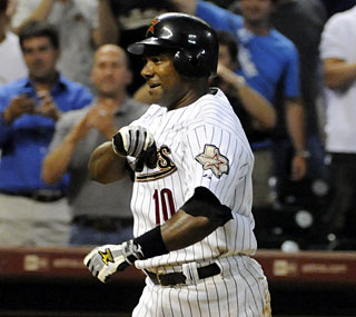 Miguel Tejada, who is the NL's leading hitter, drives his sixth homer of the season in the 11th inning.  (AP)