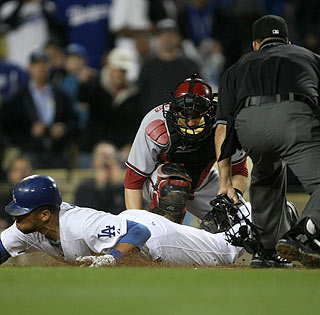 James Loney beats the tag of Miguel Montero to score the game's only run in the sixth.  (Getty Images)