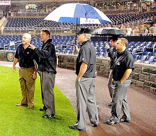 Sorry fellas, the rain won't go away so the game and Big Unit's bid for No. 300 will have to wait.  (Getty Images)