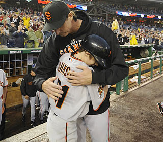 Randy Johnson, the sixth left-hander to win 300 games, receives a postgame hug from his son -- and batboy -- Tanner.