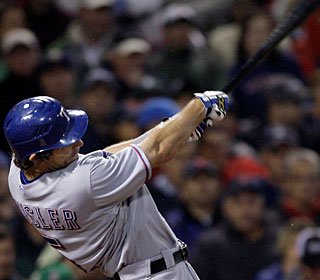 Ian Kinsler goes yard for the 15th time this season and drives in three runs.  (AP)
