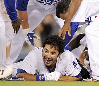 Andre Ethier doesn't mind getting tackled by teammates after his walk-off double in the ninth.  (AP)