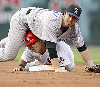Ian Stewart doesn't just swing well, he also doesn't let Rick Ankiel break up this double play. (AP)