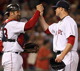 Jon Lester (pictured with Jason Varitek) strikes out 11 and earns the third complete game of his career.  (AP)