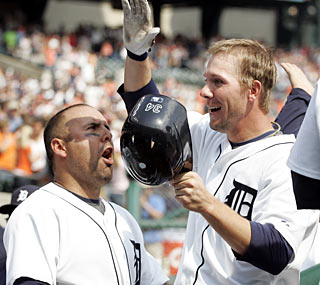 Clete Thomas (right) is a popular man in the Tigers dugout after his grand slam -- the first of his career.   (AP)