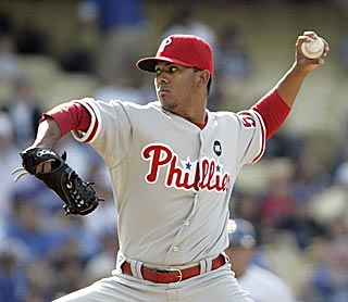 Phils rookie Antonio Bastardo, who scatters seven hits, has two victories in two major league starts.  (AP)
