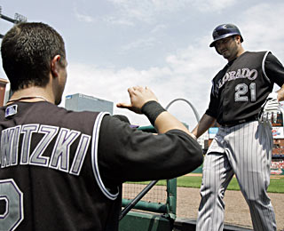 Troy Tulowitzki's bat and Jason Marquis' arm (bat, too) help the resurgent Rockies win their fifth straight.  (AP)