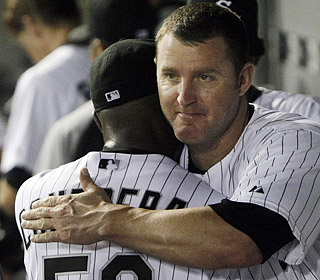 Jose Contreras' eight scoreless innings of one-hit ball are worth a congratulatory hug from Jim Thome.  (AP)