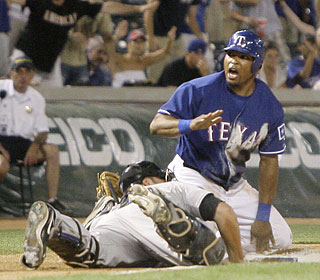Marlon Byrd isn't happy about getting tagged by Rod Barajas and being called out in a rundown.  (AP)