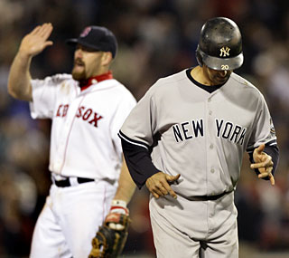 Jorge Posada and the Yankees can't solve Kevin Youkilis and the rival Red Sox this season.  (AP)