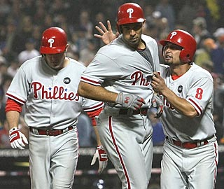 Shane Victorino (8) greets Raul Ibanez (center) after his homer rallied the Phillies to victory. (Getty Images)