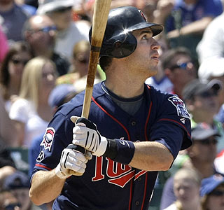 Joe Mauer watches the flight of his third-inning homer and ends the day with three RBI.  (AP)