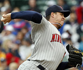 Rookie Anthony Swarzak allows only four hits over seven innings to outduel veteran Rich Harden. (AP)