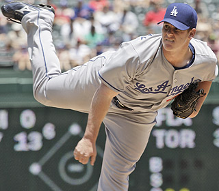 Chad Billingsley retires 16 of 17 during one stretch and yields two earned runs on five hits in seven innings.  (AP)