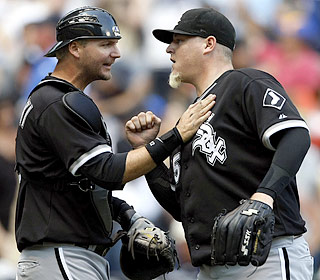A.J. Pierzynski, who knocks in the winning run with an RBI single, congratulates Bobby Jenks on the save.  (AP)