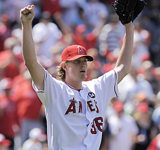 Jered Weaver is a happy guy after the final out of his first career shutout is recorded.  (AP)