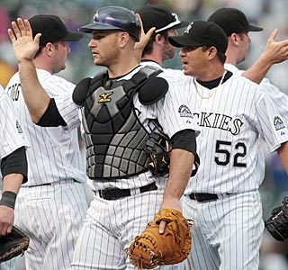 Chris Iannetta, who drove in three with a fifth-inning double, celebrates the Rockies' 11th straight win.  (AP)