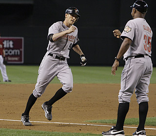 Hunter Pence rounds third base as the Astros are on their way to winning a fifth consecutive series.  (AP)