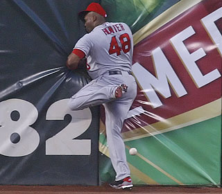 Torii Hunter crashes into the center-field wall trying to catch a deep drive from Bengie Molina.  (US Presswire)