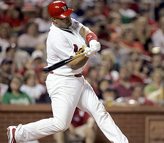 Albert Pujols goes deep for the fifth straight game. He's hitting .326 with 23 bombs this year. (AP)