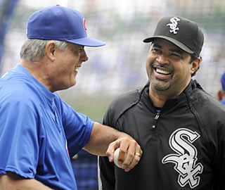 Managers Lou Piniella and Ozzie Guillen share a laugh before their teams engage in a Chicago showdown.  (AP)