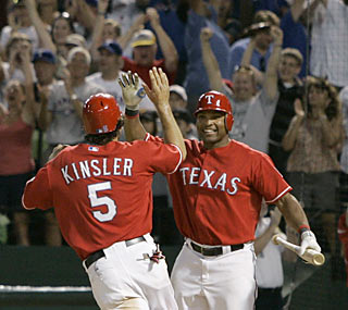 A happy Marlon Byrd waits for Ian Kinsler -- the winning run -- to cross home plate in the 10th inning.  (AP)