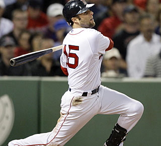 Dustin Pedroia connects for three hits to drive in three runs in the win. (AP)
