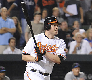 Aubrey Huff's RBI single ends the Orioles' inability to win a game when trailing after eight innings.  (AP)