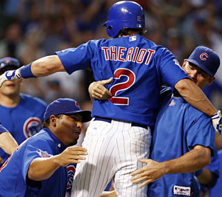 Ryan Theriot's two-out single caps the Cubs' thrilling comeback victory against the Indians.  (AP)