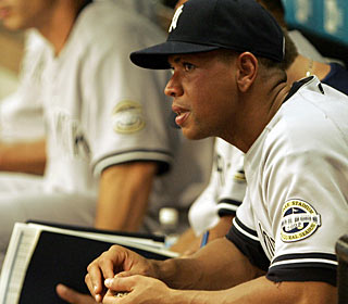 Benched for the first time this season, Alex Rodriguez observes the game from the dugout. (AP)