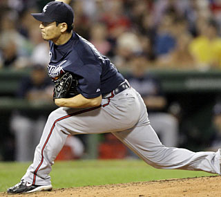 Kenshin Kawakami gives up just two hits and two runs in six innings to earn the victory.  (AP)