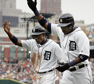 Marcus Thames (right) knocks two home runs to spearhead the Detroit offense.  (AP)