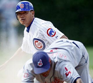 Kosuke Fukudome takes third base on an errant throw and scores the tying run in the 13th.  (AP)
