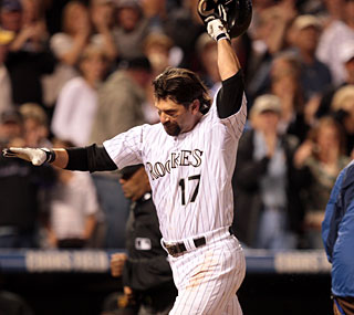 Todd Helton heads toward home plate after his dramatic homer as the Rockies have won 15 of 16.  (AP)