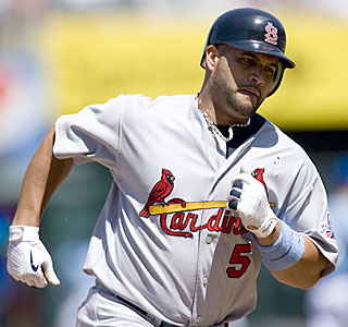 Albert Pujols goes deep twice -- including his third grand slam of the season -- and drives in six. (AP)