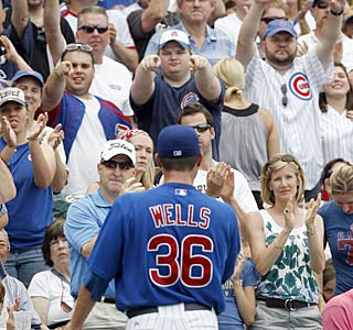 The Wrigley crowd gives Randy Wells a rousing round of applause during his first career victory.  (AP)