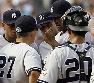 The concerned Yankees gather around CC Sabathia, who goes only 1 1/3 innings before exiting.  (AP)