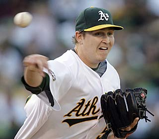 Trevor Cahill goes seven innings and allows four hits and one run for his fifth win.  (AP)
