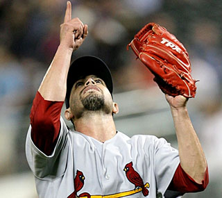 Joel Pineiro points to the sky after an outing where he records 22 outs on the ground.  (Getty Images)