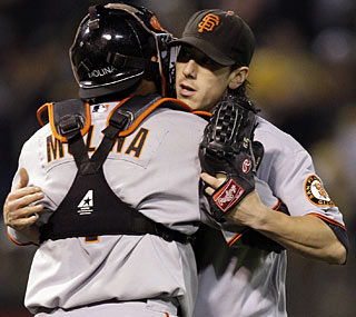 Tim Lincecum embraces Bengie Molina after his second complete game of the season -- both vs. the A's.  (AP)