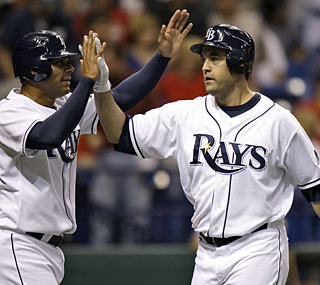 Pat Burrell (right) hits just his second home run with the Rays, but it comes against his former team.  (AP)