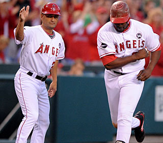 Vladimir Guerrero gets a clear path home from third-base coach Dino Ebel. (US Presswire)